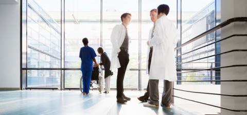Three Male Physicians Discuss Healthcare Cybersecurity