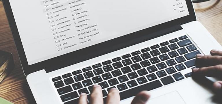 MacBook Laptop Displaying Ransomware Notifications