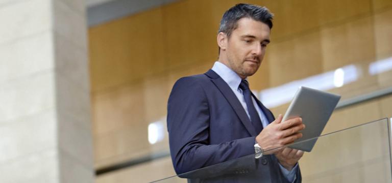 Man Using iPad - Advanced Persistent Threat
