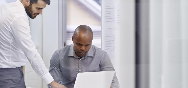 Two Male Colleagues Discuss Malicious Email Attachments