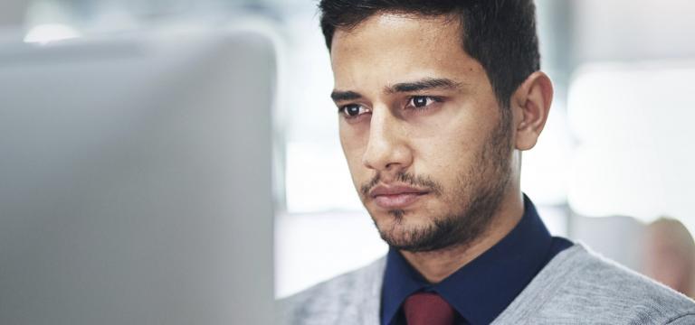 Man Uses Laptop - BEC