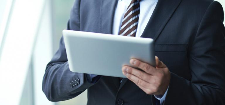 Man Checks Email on Tablet - Phishing Protection