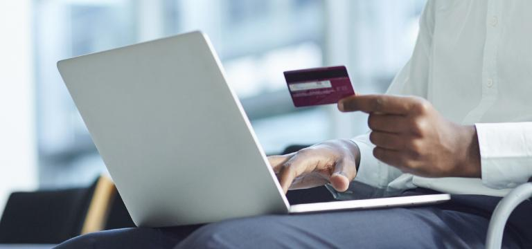 Someone Making Purchase on Laptop with a Credit Card - Ransomware