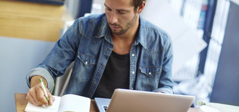 Man Using Laptop Protected by Advanced Threat Protection