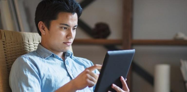 Man Taking GDPR Training Courses on iPad