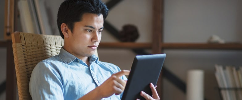 Man Using iPad Protected by Browser Isolation Technology